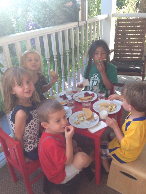 Just like separate bathrooms are key to a happy marriage, a separate kids' table is key to a happy family dinner date.