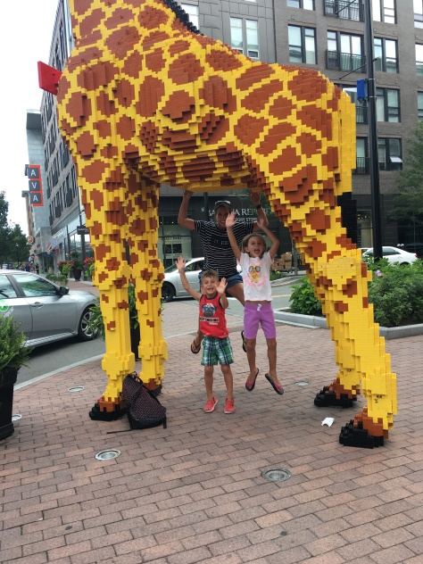 jumping under LegoLand giraffe